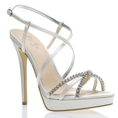 Complete your heavenly head-toe-toe ensemble with this radiant, satin strappy heel, which has a little bit of bling to go with your new ring.