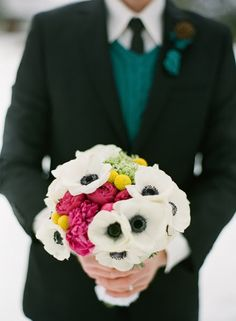 "Hot and cold for a winter wedding:  black-centered anemones, fuchsia peonies and bright yellow craspedia -- with a cable-knit ""sweater"" handle!"