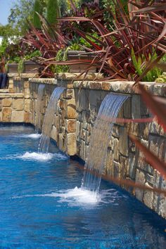 Water Features & Fountains ~ would love a pool and setting with these features-cameron stone tumbled veneer, red flax, sheer descents. Run 3 separate valves to control flow. Backyard Pool Designs, Swimming Pool Designs, Pool Landscaping, Pool Spa, Swimming Pool Fountains, Pool Water Features, Rogers Gardens, Les Cascades, Custom Pools