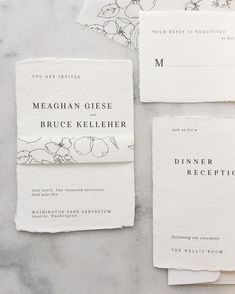 handmade paper and printed vellum white wedding invitations with hand-drawn flowers