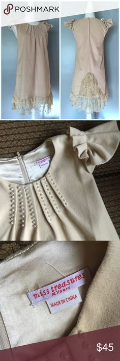 """Tan Wool Ruffle Sleeve special Occassion Dress 14 Miss Treasures luxury children's wear dress, size 15 girl. Beautiful Pearl beading at neckline,Swing silhouette, gorgeous Lace-inset bustle. In excellent pre-owned condition! Approximate Measurements: 17"""" armpit to armpit, 34.5"""" long. Color best represented in photo 2&3  🎀BUNDLE your likes and I'll send you             a special offer! 🎀REASONABLE offers WELCOME 🎀NO TRADES NO HOLDS 🎀I carry all Sizes! Search for your size! 🎀Thank you for…"""