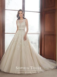 Style Y21520, Carson is a stunning tulle ball gown wedding dress designed by Sophia Tolli for her Fall 2015 Bridal Gown Collection.