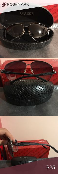 Dark sunglasses. 100% UV/UVB protection. Guess men's sunglasses. Dark lenses. Gunmetal frames. 100% UV/UVB protection. Guess Accessories Glasses