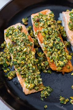 Three salmon filets topped with a pistachio herb mixture in the cast-iron pan in which they were seared. Salmon Recipe Pan, Salmon Recipes, Fish Recipes, Keto Recipes, Pan Seared Salmon, Baked Salmon, Salmon Dishes, Fish Dishes, Gourmet