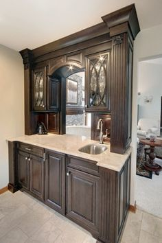 Dark Cabinets With Circle Motif In Cabinet Doors