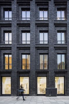 Gridded all black brick large building facade.  Storefront inspiration