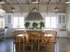Beautiful wood ceiling, white and natural cabinets, wide plank floors by Phoebe Howard