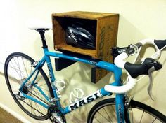 DIY Bike Shelf. Make a good looking bike shelf with recycled wood crate, and keep the bike out of the way and easy to access. http://hative.com/clever-garage-storage-and-organization-ideas/