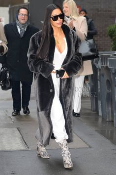 Kim Kardashian pairs fur and sweat pants again.