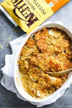 The Best Garlic Herb Cheesy Potatoes - sauteed garlic, fresh herbs, two types of potatoes, Gruyère cheese, and a golden crispy topping. SO GOOD.