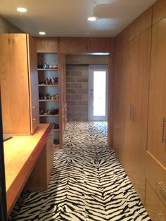 Master Walk In Closet with Zebra FLOR tiles - Amazing touch of something fun in an otherwise bland space - Love!  #florptw