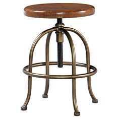 Bring industrial-chic style to your kitchen island or home bar with this timeless stool, featuring an adjustable saddle brown-finished seat and metal legs.