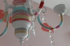 DIY Yarn Bombed Chandelier - We are obsessed with this whimsical chandelier in this dream-themed nursery. #projectnursery