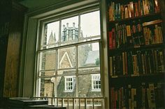 In a room full of books with a wonderful view.