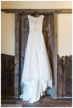 Wedding Dress on Rustic Wooden Door