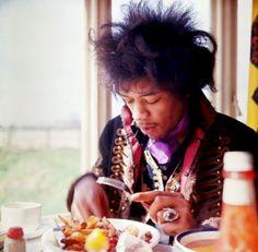 Jimi Hendrix eating breakfast, 1967.