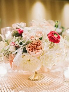 Classic centerpieces: http://www.stylemepretty.com/2015/06/05/neutral-palette-sea-island-georgia-wedding/ | Photography: Amy Arrington - http://www.amyarrington.com/