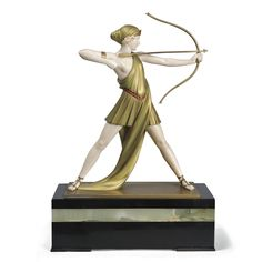 Ferdinand Preiss 'ARCHER (DIANA)' cold painted bronze and ivory, heightened with colour, green onyx and black marble base   the base marked 'F. Preiss'