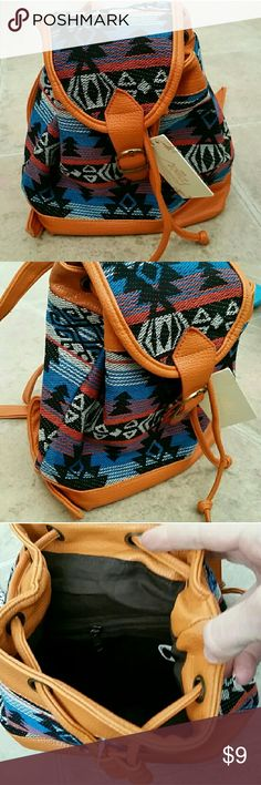 NWT mini aztec backpack purse! Super cute aztec print small backpack from boutique.  The straps zip together or apart. 10 in height by 8 inches wide.  Brand new no flaws. Ashley Collection Bags Backpacks