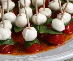 Easy to make at home classic Caprese Canapé with Grape Tomatoes, Mozzarella Pearls and Fresh Basil Leaves #recipe #hors'doeuvres