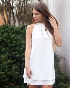 Looking for a white dress? Look no further Our top selling mock halter neck dress is now available in white! #lotusboutique