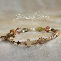 This delightful bracelet features a lovely arrangement of a semi-precious gemstone cross, Swarovski crystals, and fine glass beads. The bracelet measures in length and secures with a bronze-tone Christian Bracelets, Christian Jewelry, Gold Bar Necklace, Lariat Necklace, Crystals And Gemstones, Swarovski Crystals, Graduation Jewelry, Crystal Choker, Body Jewelry