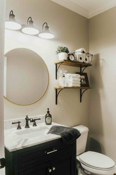 Transforming our dated powder bathroom into a clean sleek look! Check out our Powder Bathroom Makeover we completed in just 5 days. Rustic Bathroom Shelves, Rustic Bathroom Vanities, Bathroom Storage Shelves, Modern Farmhouse Bathroom, Small Bathroom, Farmhouse Decor, Condo Bathroom, Master Bathrooms, Bathroom Mirrors