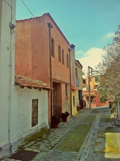 is a beautiful, quiet street that has both new and old houses. (Walking Thessaloniki, Route 08 - Seven Towers) Zappa, Acropolis, Thessaloniki, Towers, Old Houses, Daydream, Walking, Street, Beautiful