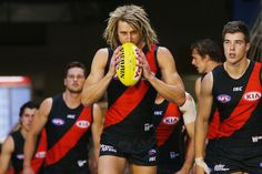 Dyson Heppell of the Bombers leads the team out during the round one AFL match between the Essendon Bombers and the Hawthorn Hawks at Melbourne Cricket Ground on March 25, 2017 in Melbourne, Australia.