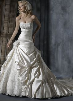 Pop the rosette and highest pick-up down to knee level and I've definitely dreamt of this dress multiple times.