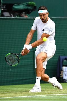Jiri Vesely of the Czech Republic plays a backhand against Rafael Nadal of Spain during their Men's Singles fourth round match on day seven of the Wimbledon Lawn Tennis Championships at All England Lawn Tennis and Croquet Club on July 9, 2018 in London, England.