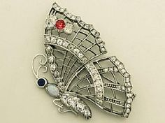 Diamond butterfly brooch | A fine and impressive vintage 3.50 carat diamond, opal, ruby and sapphire 18 carat white gold brooch.