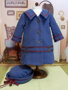 1914 Satin lined, linen coat and hat This is an original Keepers design, made from a medium blue linen fabric and lined with blue satin. The buttons are a copper color and the trim is a red and navy ribbon sewn on. Ag Doll Clothes, Doll Clothes Patterns, Clothing Patterns, Doll Patterns, Ag Clothing, American Girl Crafts, American Girl Clothes, American Girls, Vintage Girls