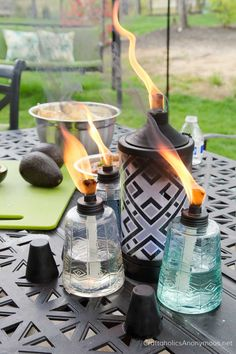 Gorgeous table top torches add a nice flare. Look at those flames! Keep those bugs away from your party! #shareacokecontest