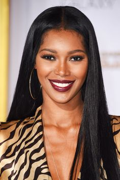 All The Best Looks From The Mockingjay Red Carpet #refinery29  http://www.refinery29.com/2014/11/78195/hunger-games-mockingjay-premiere-pictures#slide8  Sometimes, all you need is a bold lip and slick tresses, à la Jessica White.