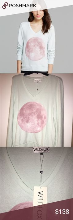 🆕 Wildfox pale blue BBJ with Pink Moon size M NWT Wildfox Couture pale blue/mint color V-neck baggy beach jumper with a pink moon graphic on the front. Perfect condition. Please view all photos and ask any questions you may have prior to purchasing 💜         ❌Trades❌ Wildfox Tops Sweatshirts & Hoodies