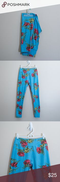 LuLaroe OS Floral Legging Used Once. One Size. Made in China. Light Blue with Red and Green Flowers. Super Soft & Comfy. I have TONS of Leggings so I need to clear out my Collection! LuLaRoe Pants Leggings