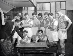 Bournemouth & Boscombe Athletic manager Freddie Cox is captured here discussing tactics with his players before an FA Cup fifth round tie against Tottenham in 1957. A 3-1 win put Bournemouth into the sixth round, where they were beaten by Manchester United