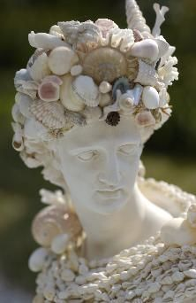 seashell and coral encrusted bust