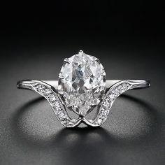 Early 1900's pear-shaped diamond ring: The ring  is from early 1900s Great Britain. A bright white 'light carater'(.90) old mine-cut pear shape diamond is presented in a finely crafted mounting in 18ct white gold.