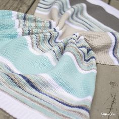 CROCHET BLANKET: Summer Boardwalk Baby Blanket; This blanket pattern, made completely of single crochet stitches, has been wonderful for that purpose! The colors are so soothing they will remind you so much of the beach while the multicolored sections will remind you of the run-down wooden planks that often line a beach boardwalk. Go check it out. #blanket #boardwalk #crochet #crochetpattern