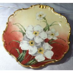 PRICE REDUCED! Antique LDBC Flambeau Limoges porcelain hand painted... (€69) ❤ liked on Polyvore featuring home, kitchen & dining, dinnerware, gold rimmed chargers, tea plate, gold trim plates, limoges porcelain plates and flambeau