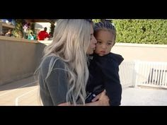 Kim Kardashian plants a kiss on her sweet son as she and Kourtney throw ...