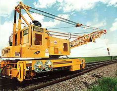 A railroad crane, (US: crane car or wrecker; UK: breakdown crane) is a type of crane used on a railroad for one of three primary uses: freight handling in goods yards, permanent way (PW) maintenance, and accident recovery work.