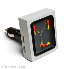 ThinkGeek :: Flux Capacitor Car Charger  I want I want, I don't care if its a real product or not, I want it, make it now!  LOL