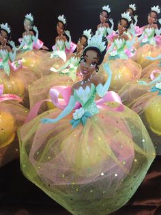 Princess Tiana candy apples. Cute idea to use colored netting for packaging
