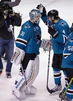 San Jose Sharks defenseman Brenden Dillon congratulates goaltender Antti Niemi after his 31 save shutout of the Chicago Blackhawks (Jan. 31, 2015).