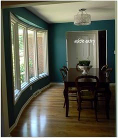 calypso blue by benjamin moore i think we have figured i like turquoise... and now i am doing the dining room too.