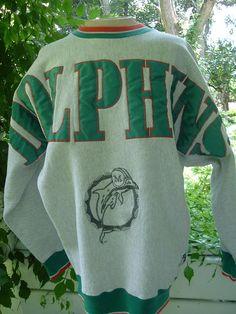 c015402852fcb5 Retro Crew Neck Miami Dolphins Sweatshirt. NFL Miami Dolphins Sweatshirt,  Nfl, Crew Neck