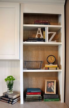 Wallpapering the back of shelving units with burlap. LOVE this look!